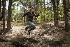 Jumping during jogging Stock Photography