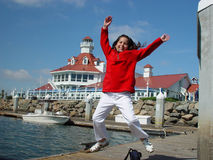 Jumping for joy!. This is the daughter on her first photoshop in long beach, California Stock Photography