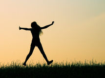 Jumping for Joy. The child jumps for joy at her success Stock Image