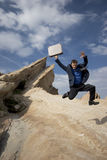 Jumping for joy. Business concepts - man jumping in the desert Royalty Free Stock Photography