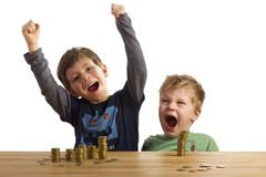 Jumping for joy. Two happy boys in front of money Stock Images
