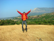 Jumping with Joy. An Indian guy jumping with joy on achieving success Stock Photography