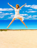 Jumping in joy. On a beach Stock Images