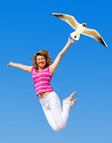Jumping in joy. On sky background Royalty Free Stock Images