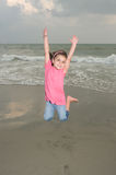 Jumping for Joy. Adorable young girl happy jumping at the beach Stock Photography