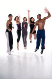 Jumping with joy. Group of multiracial young adults jumping with joy in fitness wear. All logos removed Royalty Free Stock Images