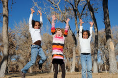 Jumping With Joy. A picture of three girls jumping with joy, in a park Stock Images