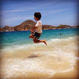 Jumping for Joy in Cabo! Royalty Free Stock Photo