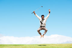 Jumping for joy at his golf handicap Royalty Free Stock Photos