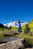 Jumping for Joy at Maroon Bells Stock Image