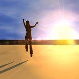 Jumping for joy at sunrise Royalty Free Stock Image