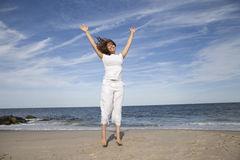 Jumping with Joy. Woman jumping with joy at the beach Royalty Free Stock Image