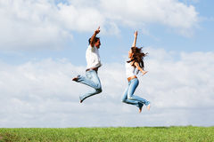Jumping joyful couple Royalty Free Stock Images