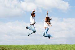 Jumping Joyful Couple Royalty Free Stock Images
