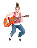 Jumping joyful woman with electric guitar Royalty Free Stock Image