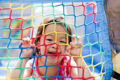 Jumping Jungle Fun. Toddler playing in a jumping gym, or bouncy castle Royalty Free Stock Photography