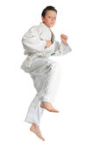 Jumping karate boy Royalty Free Stock Images