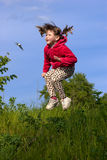 Jumping kid Stock Photography