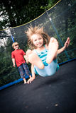 Jumping kids. Jupming kids on the trampoline in the garden royalty free stock photography