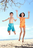 Jumping kids in the beach Stock Photo