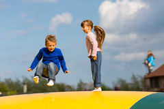 Jumping kids Royalty Free Stock Image