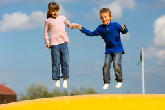 Jumping kids Royalty Free Stock Photo