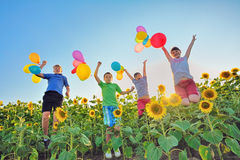 Jumping kids on field Royalty Free Stock Photos