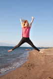 Jumping lady Stock Photography