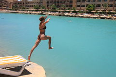 Jumping in a lagoon in Egypt stock image