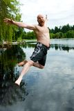 Jumping in a lake Royalty Free Stock Photography