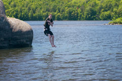 Jumping in the lake royalty free stock photography