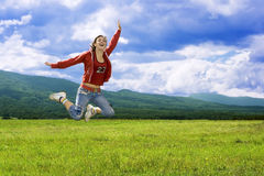 Jumping laughter girl. Young beautiful laughter girl in a happy jump royalty free stock photo