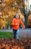 Jumping in the Leaves Stock Photo