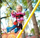 Jumping littele girl. Little girl jumping on the trampoline with rubber bands stock image