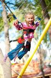 Jumping littele girl. Little girl jumping on the trampoline with rubber bands royalty free stock images