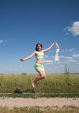 Jumping long-haired teen girl Stock Images