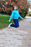 Jumping lovely teen girl royalty free stock images
