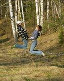Jumping Loving young couple Stock Images