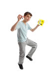 Jumping male teen Drive L Plates. A jumping teenager holding car key and yellow L learner driver plates royalty free stock images