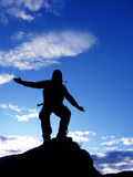 Jumping man. Jump man on a blue sky Royalty Free Stock Images