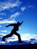 Jumping man. Jump man on a blue sky Stock Photos