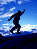 Jumping man. Jump man on a blue sky Royalty Free Stock Photography