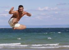Jumping man in Bulgaria. Athletic young man enjoying the summer, jumping in a Bulgarian,Black sea beach Stock Photo