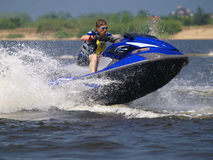 Jumping man on jet ski Stock Images