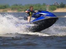 Jumping man on jet ski. Man on jet ski jump on the wave Stock Images