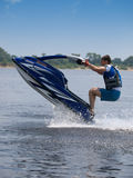 Jumping man on jet ski Stock Photos