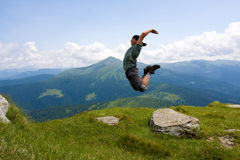 Jumping man in mountains Stock Photo