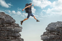 Jumping Man. Man jumping over a canyon Stock Image