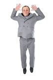 Jumping man senior. In grey suit Stock Photography