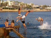 Jumping in the mediteranian sea Stock Image
